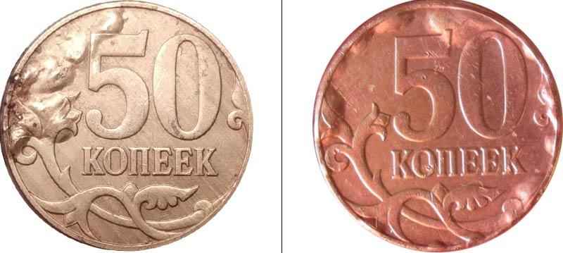 вздутия на монете из-за коррозии стального ядра